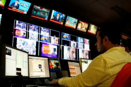 FILE PHOTO: An employee works at the control room of the Geo News television channel in Karachi