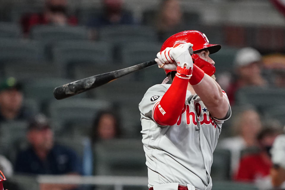 Philadelphia Phillies' Bryce Harper (3) follows through on a home run in the sixth inning of a baseball game against the Atlanta Braves, Sunday, April 11, 2021, in Atlanta. (AP Photo/John Bazemore)