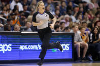 Referee Jenna Schroeder runs during the second half of an NBA basketball game between the Phoenix Suns and Denver Nuggets, Saturday, Feb. 8, 2020, in Phoenix. With more female referees now in the NBA than ever before, it was only a matter of time before two women would be scheduled to work the same game. And Monday, Jan. 25, 2021, became that day. Natalie Sago and Jenna Schroeder made up two-thirds of the crew assigned to the Charlotte at Orlando game, the first time in NBA history that two women would be working a regular-season contest together. (AP Photo/Ralph Freso)