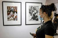 """A visitor views the works of Tunisian photographer Jacques Perez during the launch of his exhibition """"Memories before Oblivion"""" (AFP/FETHI BELAID)"""