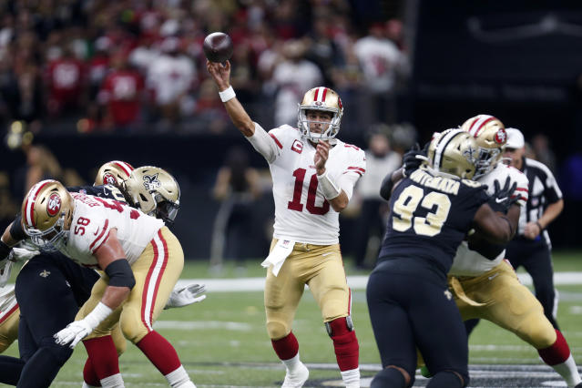 San Francisco 49ers quarterback Jimmy Garoppolo (10) passes in the first half an NFL football game against the New Orleans Saints in New Orleans, Sunday, Dec. 8, 2019. (AP Photo/Butch Dill)