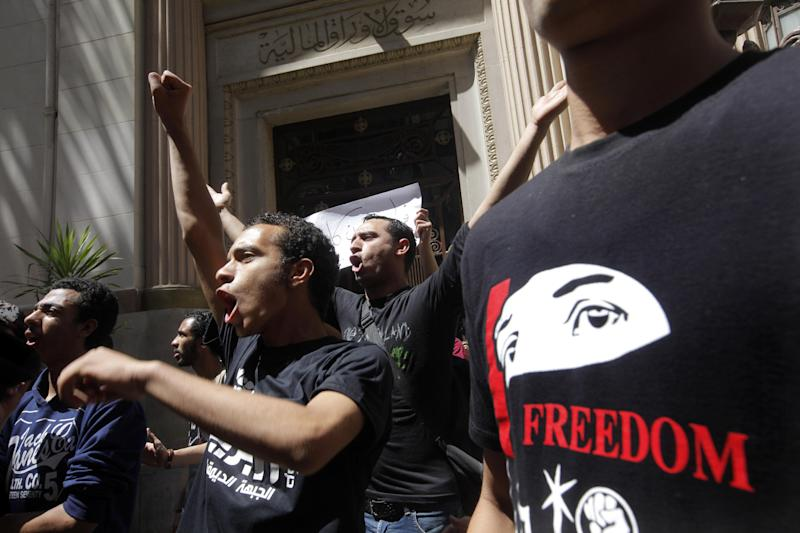 Members of Egypt's April 6 Youth Movement shout anti-Muslim Brotherhood slogans during a rally in front of Cairo's stock market, in Cairo, Egypt, Saturday, April 6, 2013. The group is rallying to mark its fifth anniversary and to protest against President Mohammed Morsi. (AP Photo/Amr Nabil)