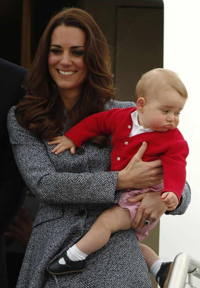 Britain's Catherine, the Duchess of Cambridge, holds her son Prince George as they prepare to board a plane with her husband Prince William (not pictured) to depart Canberra April 25, 2014. The Prince and his wife Kate are undertaking a 19-day official visit to New Zealand and Australia with their son Prince George. REUTERS/Phil Noble (AUSTRALIA - Tags: POLITICS ENTERTAINMENT ROYALS TPX IMAGES OF THE DAY)