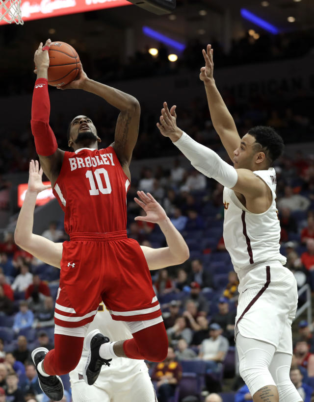 Bradley's Elijah Childs (10) shoot over Loyola of Chicago's Marques Townes during the second half of an NCAA college basketball game in the semifinal round of the Missouri Valley Conference tournament, Saturday, March 9, 2019, in St. Louis. Bradley won 53-51. (AP Photo/Jeff Roberson)