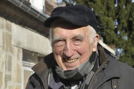 Jean Vanier, poses outside his home in Trosly-Breuil, in this picture taken March 7, 2015. Vanier, a Canadian who launched an international network of communities for the mentally disabled, has won the 2015 Templeton Prize worth $1.7 million for affirming life's spiritual dimension March 11, 2015. REUTERS/Tom Heneghan