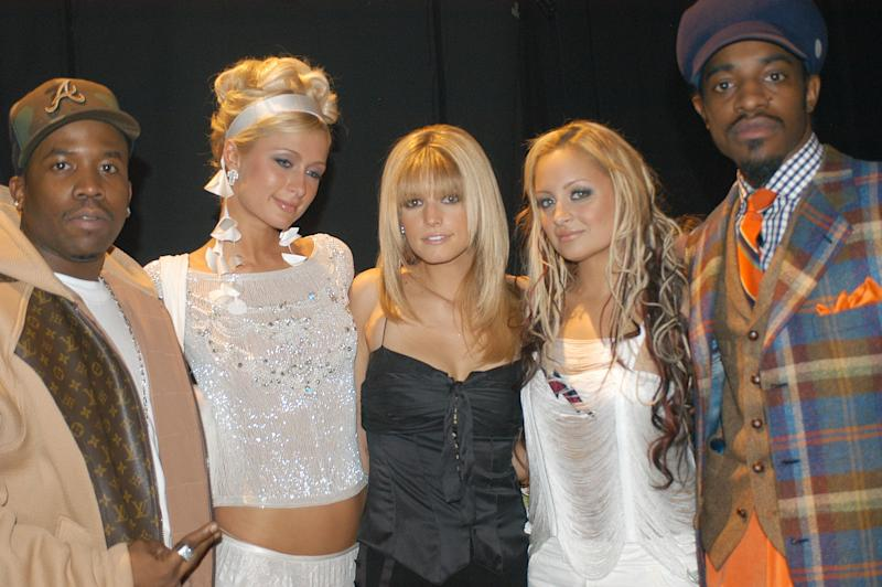 "Paris Hilton with fellow socialite, Nicole Richie (second from right) and (from left) ""self-made"" musicians Big Boi, Jessica Simpson and André 3000 at the 2003 Billboard Music Awards. (Photo: Denise Truscello via Getty Images)"