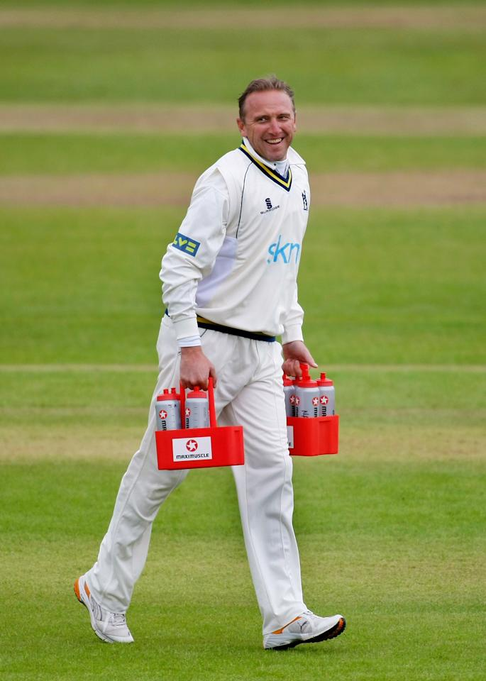 TAUNTON, ENGLAND - APRIL 17:  Warwickshire coach Allan Donald dons his whites to do the 12th man drinks duties during the third day of the LV County Championship Division One match between Somerset and Warwickshire at The County Ground on April 17, 2009 in Taunton, England.  (Photo by Stu Forster/Getty Images)