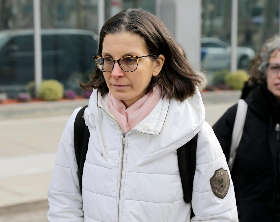 Clare Bronfman leaves Brooklyn federal court in New York, Monday, Jan. 28, 2019. Court papers say a trust largely funded by Seagram's liquor fortune heiress Bronfman is bankrolling the defense for her co defendants in a sex trafficking case.
