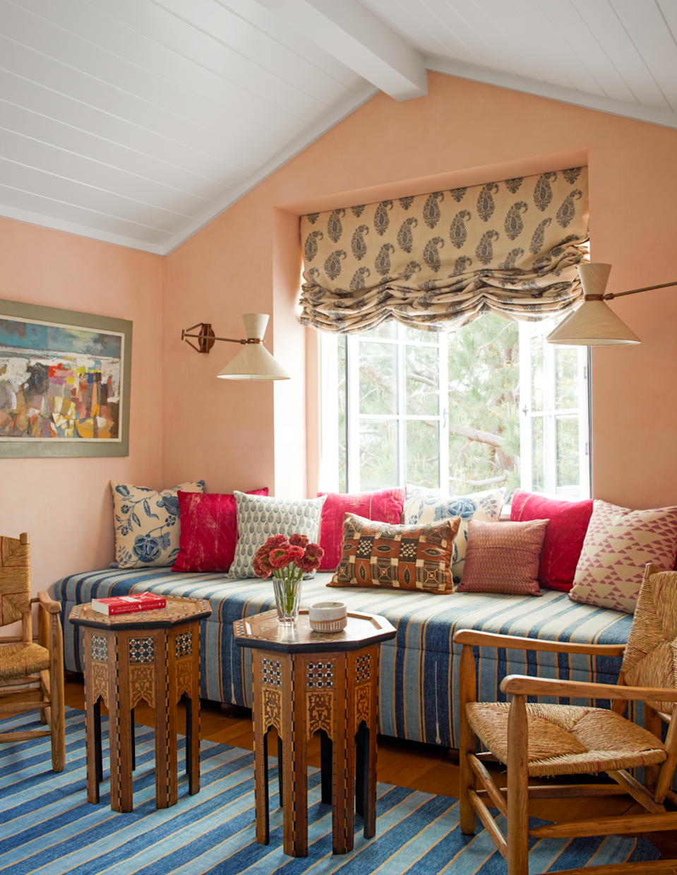 """<p>Soft and peachy pinks have a calming effect, especially when paired with rich textiles like in this <a href=""""https://peterdunhamtextiles.com/"""" rel=""""nofollow noopener"""" target=""""_blank"""" data-ylk=""""slk:Peter Dunham"""" class=""""link rapid-noclick-resp"""">Peter Dunham</a>–designed <a href=""""https://www.veranda.com/home-decorators/a30735967/peter-dunham-california-house-tour/"""" rel=""""nofollow noopener"""" target=""""_blank"""" data-ylk=""""slk:Newport Beach home."""" class=""""link rapid-noclick-resp"""">Newport Beach home.</a> Indian cotton dhurries grace the sofa and floor, and the sconces are <a href=""""https://www.richardtaylordesigns.co.uk/"""" rel=""""nofollow noopener"""" target=""""_blank"""" data-ylk=""""slk:Richard Taylor Designs"""" class=""""link rapid-noclick-resp"""">Richard Taylor Designs</a>.</p><p><a class=""""link rapid-noclick-resp"""" href=""""https://www.farrow-ball.com/en-us/paint-colours/setting-plaster"""" rel=""""nofollow noopener"""" target=""""_blank"""" data-ylk=""""slk:Get the Look"""">Get the Look</a></p>"""