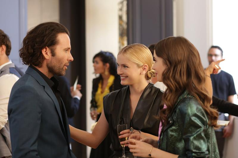 EMILY IN PARIS, Camille Razat (center), Lily Collins (right), (Season 1, ep. 104, aired Oct. 2, 2020). photo: Carole Bethuel / Netflix / Courtesy Everett Collection
