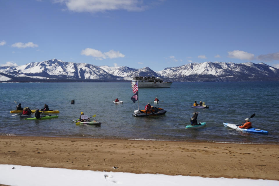 Watercraft of various types float on Lake Tahoe on Lake Tahoe offshore of the temporary ice rink where the Golden Knights will play the Colorado Avalanche in an NHL hockey game at Stateline, Nev., Saturday, Feb. 20, 2021. (AP Photo/Rich Pedroncelli))