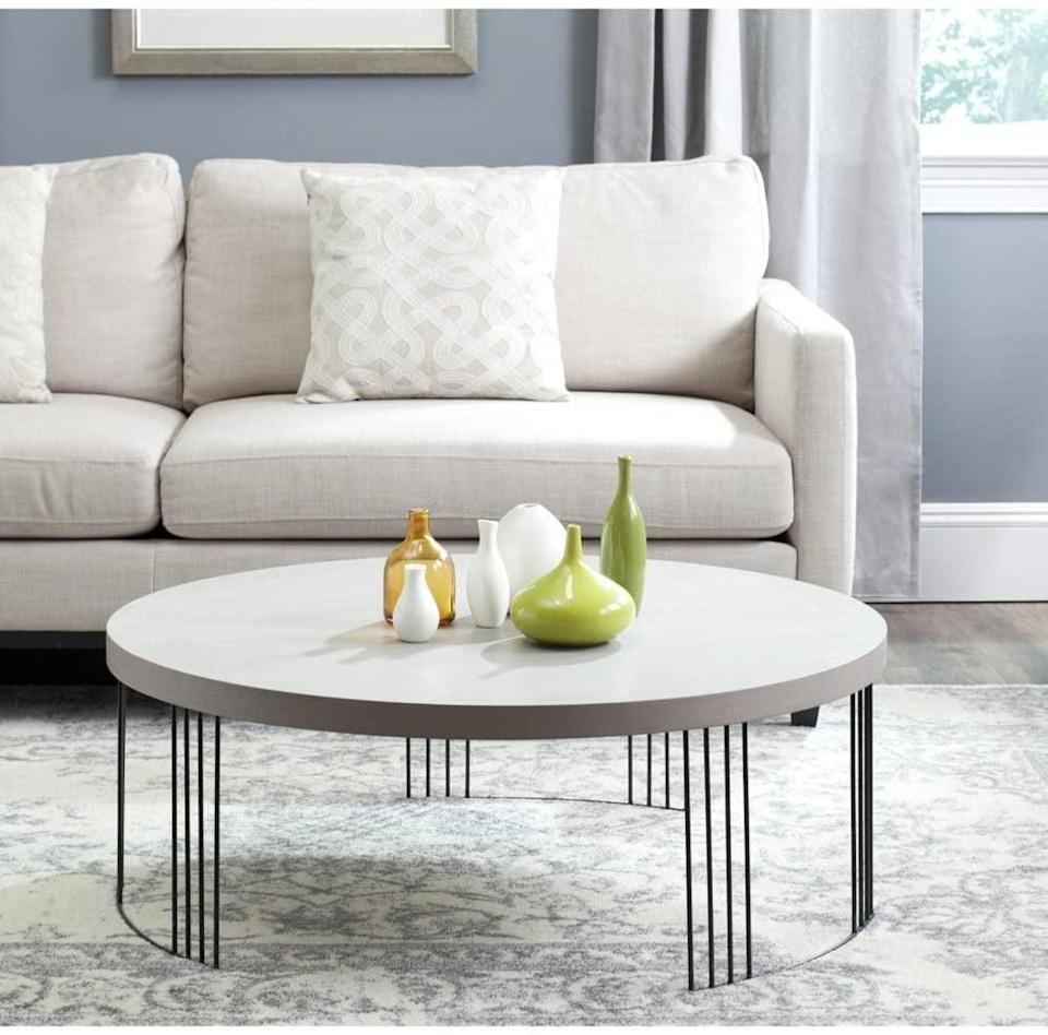 <p>If you're looking for a more modern coffee table, get the <span>Safavieh Home Collection Keelin Coffee Table</span> ($195).</p>