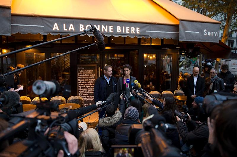 Audrey Bily (R) and Romain Debray, managers of A la Bonne Biere, hold a press conference on December 4, 2015 during the reopening of the venue in Paris The Paris bar where five people were killed by jihadist gunmen in the November 13 attacks is the first of the attacked bars to re-open, in an emotional step in the city's struggle to regain normality. (AFP Photo/Kenzo Tribouillard)