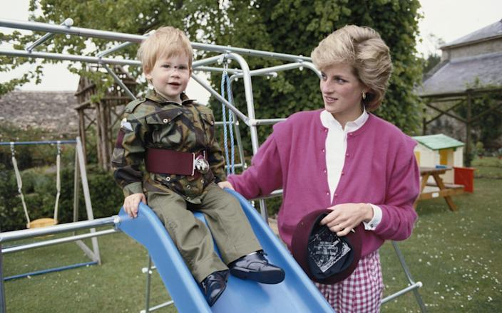 Prince Harry wearing the uniform of the Parachute Regiment of the British Army in 1986, accompanied by his mother, Diana, Princess of Wales - Tim Graham
