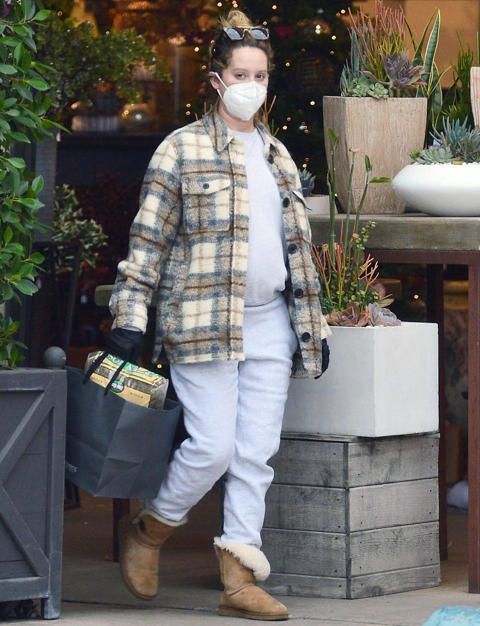 <p>Ashley Tisdale shows off her growing baby bump as she visits Rolling Greens Nursery with husband Christopher French in L.A. on Friday. </p>