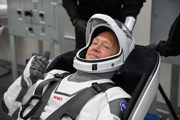 Hurley rehearsing putting on his SpaceX spacesuit in the Astronaut Crew Quarters inside the Neil A. Armstrong Operations and Checkout Building at the agency's Kennedy Space Center in Florida on Saturday during a full dress rehearsal ahead of NASA's SpaceX Demo-2 mission to the International Space Station.