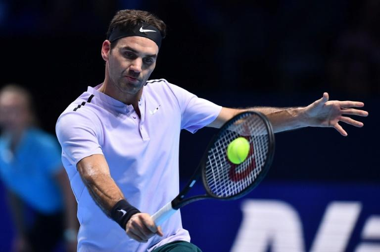 Switzerland's Roger Federer returns against Germany's Alexander Zverev during their men's singles round-robin match at the ATP World Tour Finals tennis tournament November 14, 2017