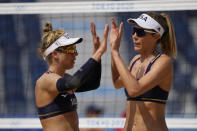 April Ross, left, of the United States, and teammate Alix Klineman celebrate a play during a women's beach volleyball match against Cuba at the 2020 Summer Olympics, Monday, Aug. 2, 2021, in Tokyo, Japan. (AP Photo/Petros Giannakouris)