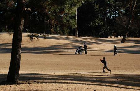 People play golf at Kasumigaseki Country Club in Kawagoe, Saitama Prefecture, Japan, January 25, 2017.   REUTERS/Oh Hyun
