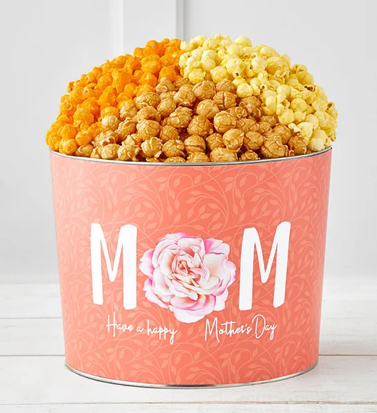 "<h2>The Popcorn Factory Blooms For Mom Popcorn Tin</h2><br>A giant pink urn of caramel, butter, and cheddar-flavored popcorn? Sign us up.<br><br><strong>The Popcorn Factory</strong> Blooms For Mom 2 Gallon Popcorn Tin, $, available at <a href=""https://go.skimresources.com/?id=30283X879131&url=https%3A%2F%2Fwww.thepopcornfactory.com%2Fblooms-for-mom-popcorn-tins-tpf-84140"" rel=""nofollow noopener"" target=""_blank"" data-ylk=""slk:The Popcorn Factory"" class=""link rapid-noclick-resp"">The Popcorn Factory</a>"