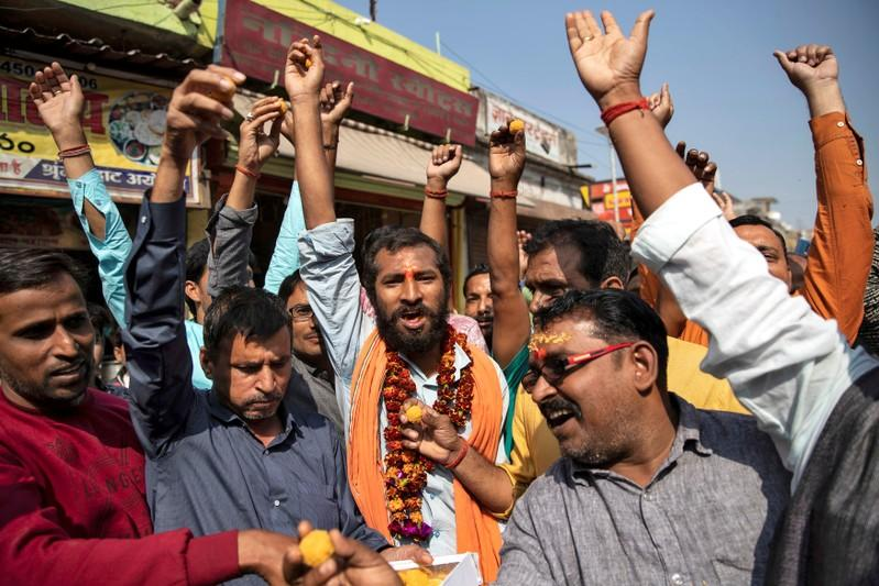 Hindu devotees celebrate after Supreme Court's verdict on a disputed religious site, in Ayodhya