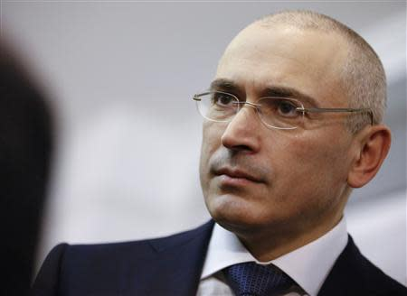 Freed Russian former oil tycoon Mikhail Khodorkovsky visits the Museum Haus am Checkpoint Charlie Berlin, December 22, 2013. REUTERS/Thomas Peter