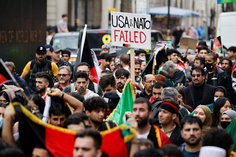 """Signs which read """"Stop the oppression of Afghan women"""", """"Afghanistan is bleeding"""" were held high    (AFP via Getty Images)"""