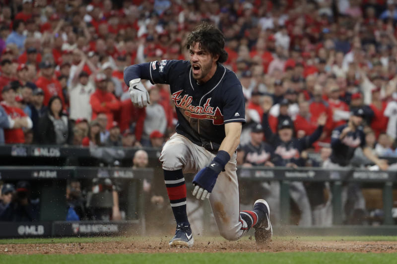 Atlanta Braves' Dansby Swanson reacts as he scores a run during the ninth inning in Game 3 of a baseball National League Division Series against the St. Louis Cardinals, Sunday, Oct. 6, 2019, in St. Louis. (AP Photo/Jeff Roberson)