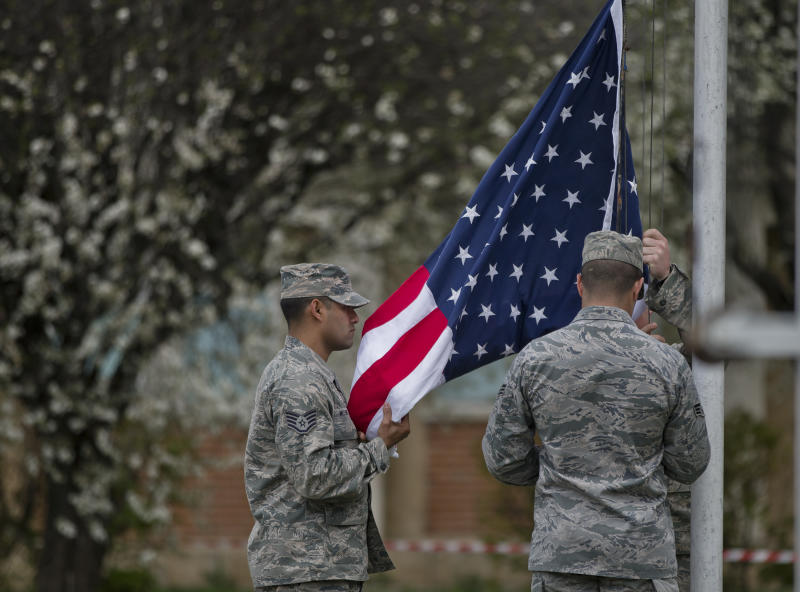 Members of the US air force raise the US flag during a ceremony at a Romanian air base in Campia Turzii, Romania, Thursday, April 10, 2014. Some 450 U.S. and Romanian troops are taking part in the Dacian Viper 2014 joint military exercise in Transylvania, northwestern Romania flying U.S. F-16 fighter jets of the U.S. 31st Fighter Wing alongside Romanian Mig-21 Lancers.The weeklong exercise, the fourth of its kind, was planned before Russia's recent annexation of Crimea, according to officials.(AP Photo/Vadim Ghirda)