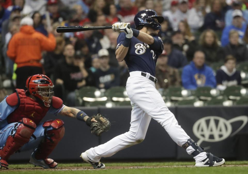 Milwaukee Brewers' Christian Yelich hits a home run during the first inning of a baseball game against the St. Louis Cardinals Saturday, March 30, 2019, in Milwaukee. (AP Photo/Morry Gash)
