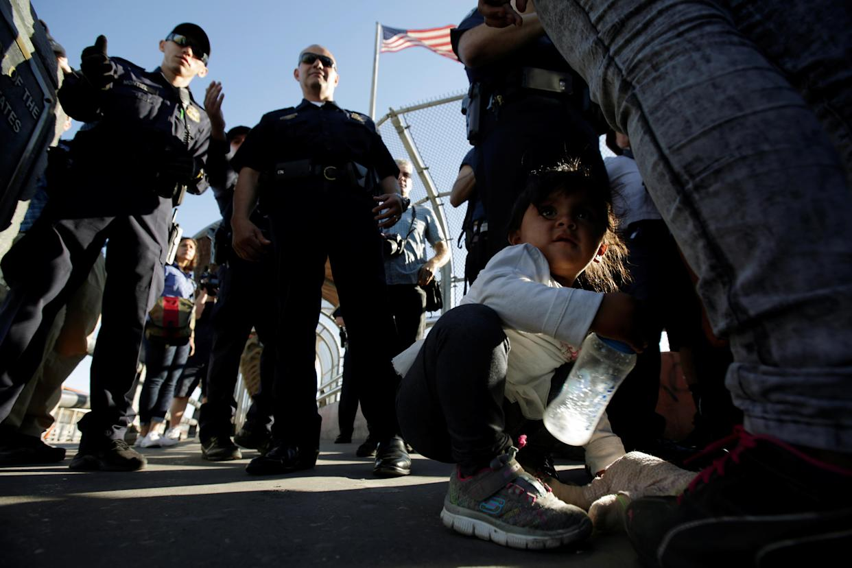 "<span class=""s1"">Migrant families from Mexico, fleeing from violence, listen to officers of the U.S. Customs and Border Protection before enter the United States to apply for asylum at the Paso del Norte international border crossing bridge in Ciudad Juarez, on June 20. (Photo: Jose Luis Gonzalez/Reuters)</span>"