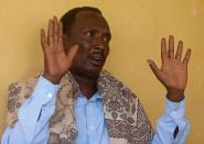Ali Jamac, whose son died after he was taken for military training reacts during a Reuters interview in Mogadishu
