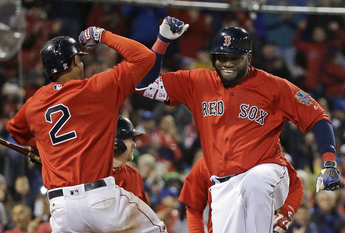 David Ortiz celebrates his two-run home run with Xander Bogaerts. (AP)