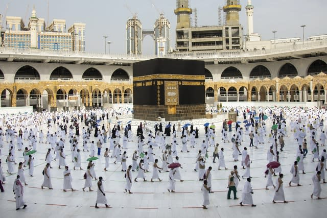 Pilgrims walk around the Kabba at the Grand Mosque, in the Muslim holy city of Mecca in Saudi Arabia