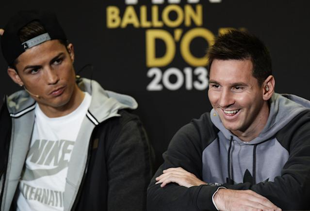 Cristiano Ronaldo of Portugal, left, and Lionel Messi of Argentina, right, nominees for the Men's World Soccer Player of the year, answer journalists questions during a press conference at the FIFA Ballon d'Or awarding ceremony in Zurich, Switzerland, Monday, Jan. 13, 2014. (AP Photo/Keystone,Steffen Schmidt)