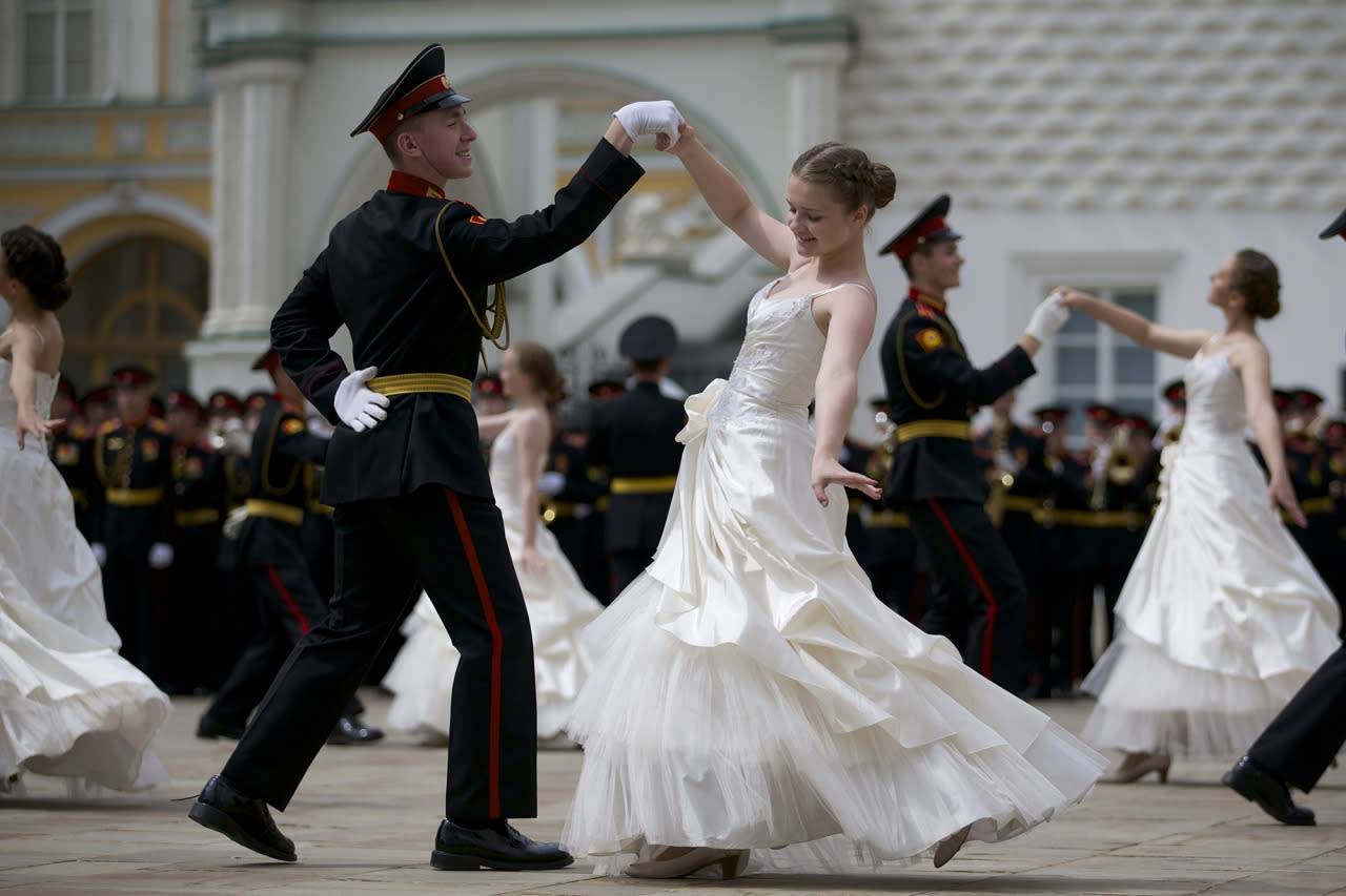 <p>Russian cadets dance the waltz during a graduation ceremony in Moscow, Russia, June 25, 2016. After giving the oath to the Russian flag, girls and boys – graduates of Moscow cadet schools received their diplomas during the official ceremony held inside of the Moscow Kremlin. (Photo: Ivan Sekretarev/AP) </p>