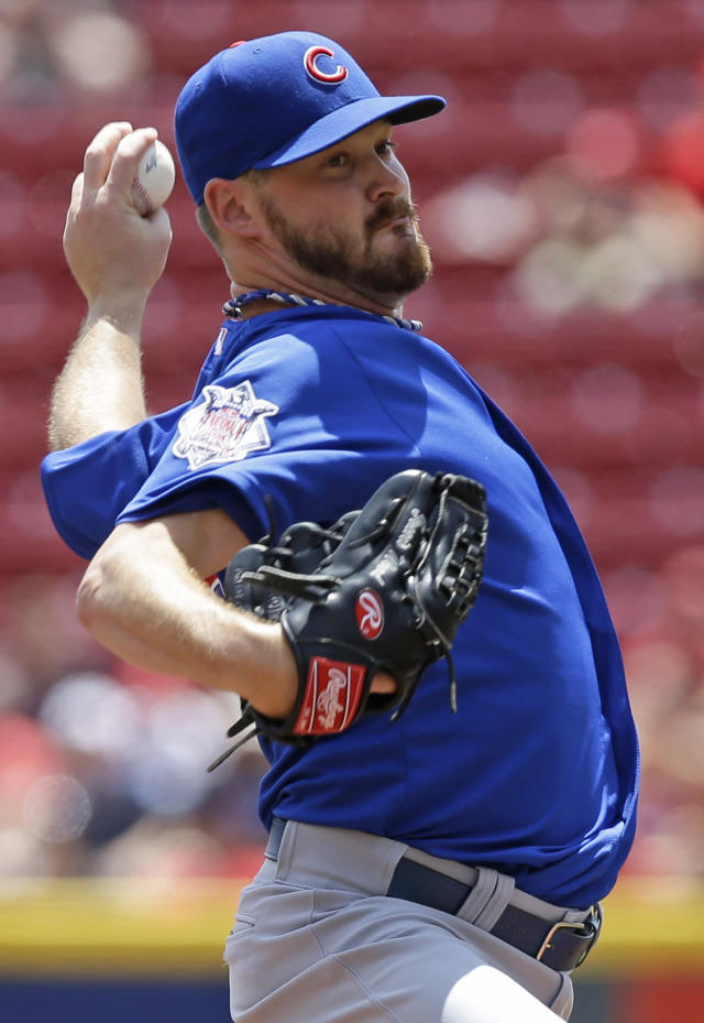 Chicago Cubs starting pitcher Travis Wood throws against the Cincinnati Reds in the first inning of a baseball game, Tuesday, July 8, 2014, in Cincinnati. (AP Photo/Al Behrman)