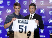 Seattle Mariners' Ichiro Suzuki, right, holds up his jersey with Mariners general manager Jerry Dipoto during a news conference at the teams' spring training baseball complex Wednesday, March 7, 2018, in Peoria, Ariz. Suzuki signed a one-year deal with the team. (AP Photo/Matt York)