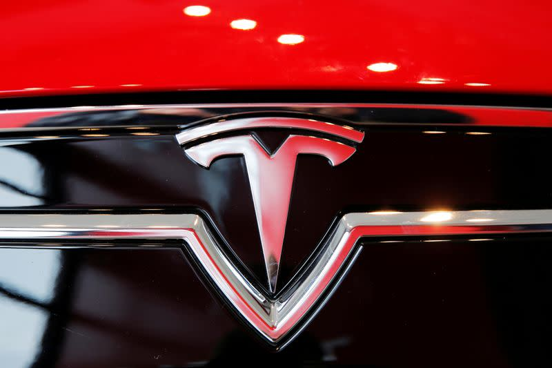 FILE PHOTO: A Tesla logo on a Model S is photographed inside of a Tesla dealership in New York