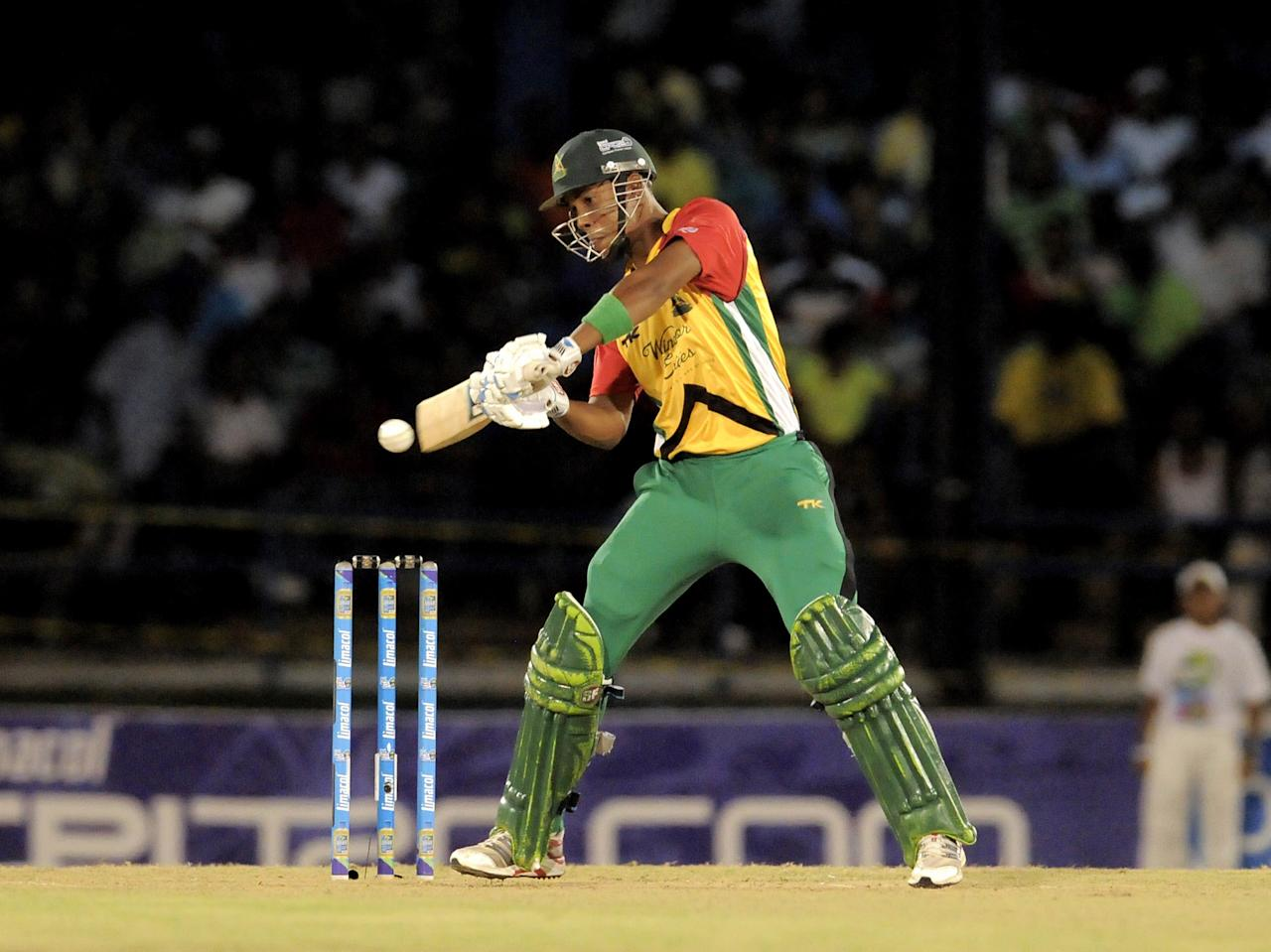 PORT OF SPAIN, TRINIDAD AND TOBAGO - AUGUST 24:  Lendl Simmons of Guyana Amazon Warriors hits a 4 against Jamaica Tallawahs during the Final of the Caribbean Premier League between Guyana Amazon Warriors v Jamaica Tallawahs at Queens Park Oval on August 24, 2013 in Port of Spain, Trinidad and Tobago. (Photo by Randy Brooks/Getty Images Latin America for CPL)