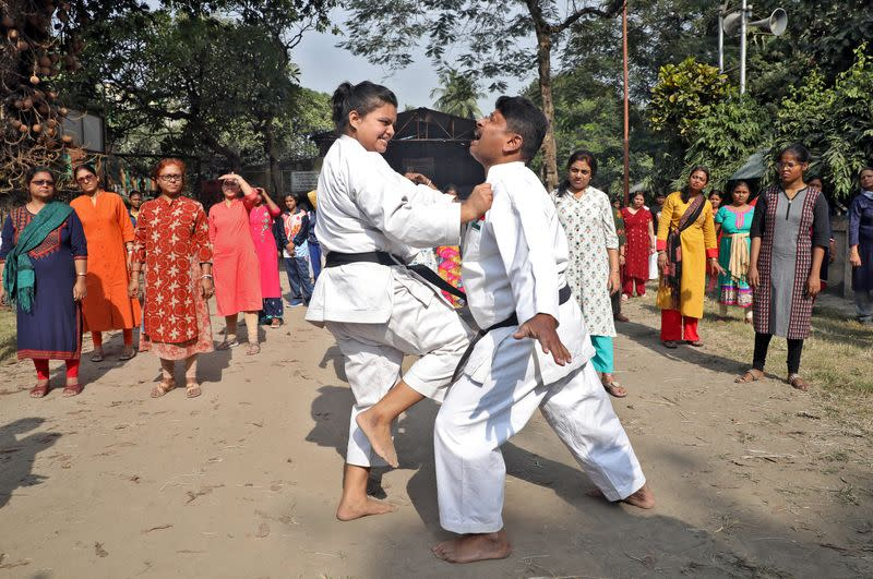 Instructors demonstrate self-defense techniques to women at a training camp in Kolkata