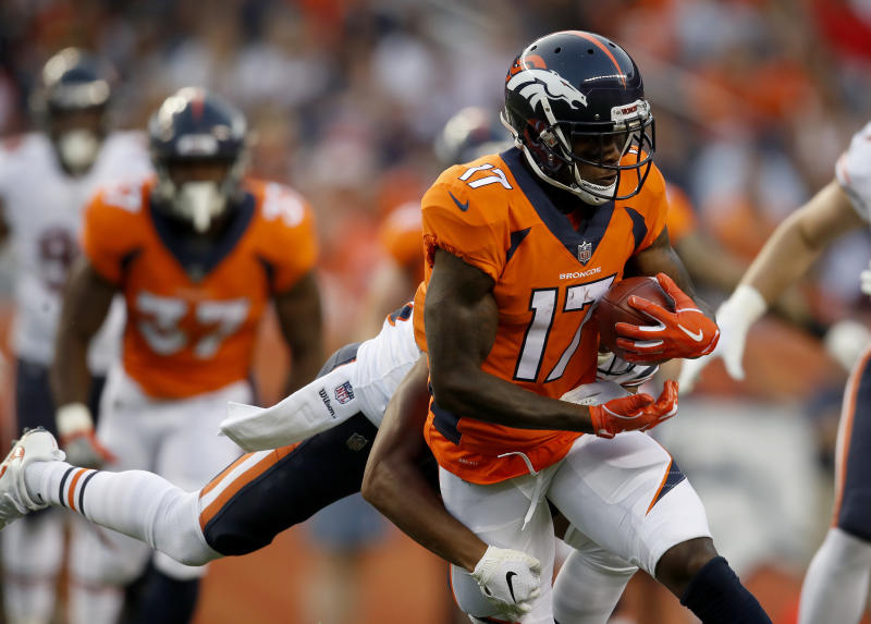 Denver Broncos wide receiver DaeSean Hamilton (17) is hit against the Chicago Bears during the first half of a preseason NFL football game, Saturday, Aug. 18, 2018, in Denver. (AP Photo/David Zalubowski)