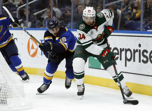 Minnesota Wild's Matt Dumba (24) controls the puck as St. Louis Blues' Robby Fabbri (15) defends during the second period of an NHL hockey game Sunday, Nov. 11, 2018, in St. Louis. (AP Photo/Jeff Roberson)