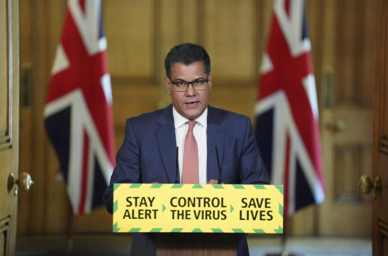 In this photo issued by 10 Downing Street, Britain's Business, Energy and Industrial Strategy Secretary Alok Sharma speaks during a coronavirus media briefing in Downing Street, London, Tuesday, May 12, 2020. (Pippa Fowles/10 Downing Street via AP)