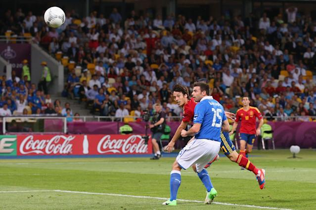KIEV, UKRAINE - JULY 01: David Silva (L) of Spain scores the opening goal during the UEFA EURO 2012 final match between Spain and Italy at the Olympic Stadium on July 1, 2012 in Kiev, Ukraine. (Photo by Alex Livesey/Getty Images)