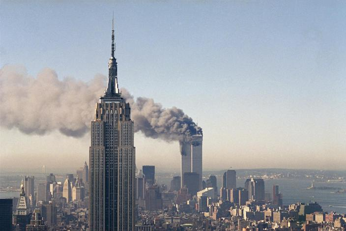 <p>The twin towers of the World Trade Center burn behind the Empire State Building, Sept. 11, 2001. (Photo: Marty Lederhandler/AP) </p>