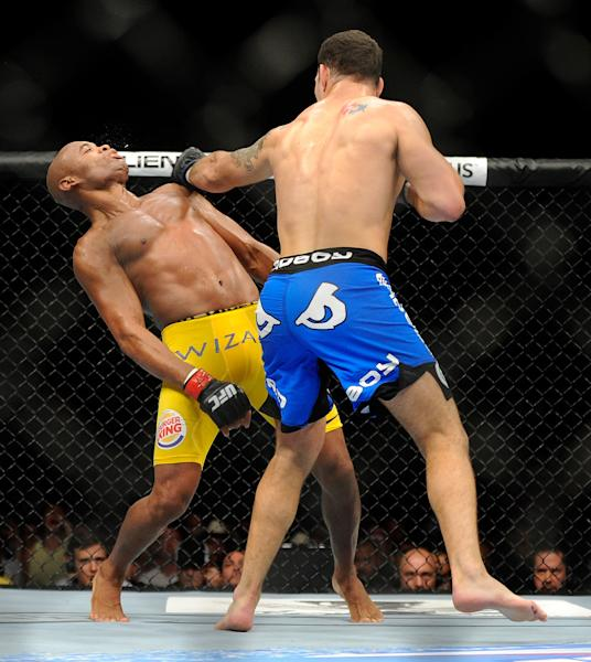 Chris Weidman connects with Anderson Silva during the second round during their UFC 162 mixed martial arts middleweight championship bout at the MGM Grand Garden Arena on Saturday, July 6, 2013, in Las Vegas. Weidman won the fight with a TKO. (AP Photo/David Becker)