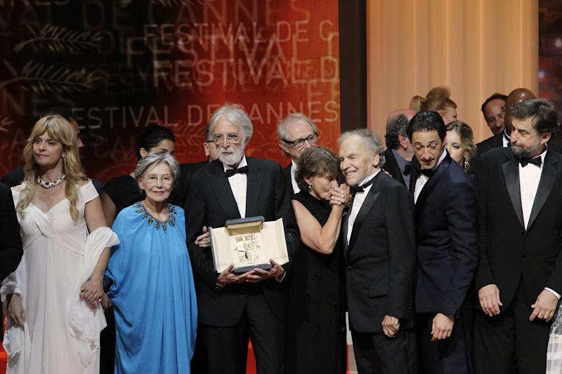 From left, actors Nastassia Kinski, Emmanuelle Riva, director Michael Haneke with the Palme d'Or award for Love, an unidentified person, actors Jean-Louis Trintignant, Adrien Brody and President of the Jury Nanni Moretti pose during the awards ceremony at the 65th international film festival, in Cannes, southern France, Sunday, May 27, 2012. (AP Photo/Francois Mori)