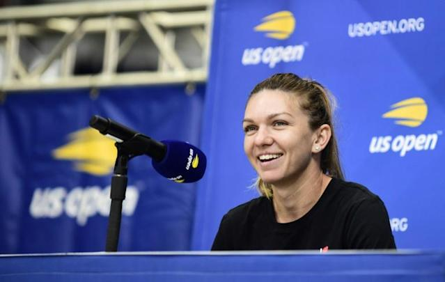 Reigning Wimbledon champion Simona Halep of Romania smiles during an interview session friday at the US Open (AFP Photo/Emilee Chinn)