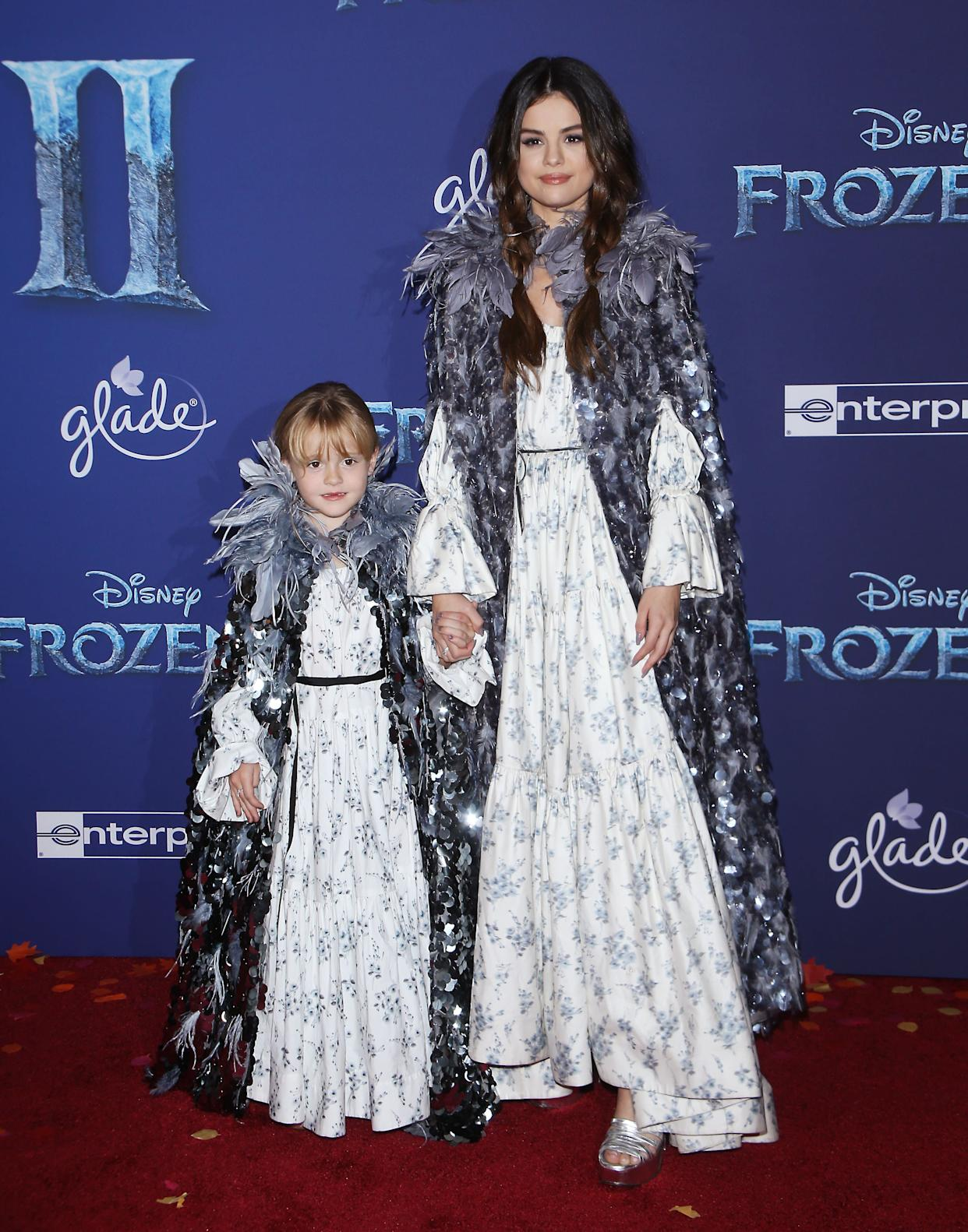 A full-length view of the sisters' matching outfits. (Photo: Michael Tran via Getty Images)